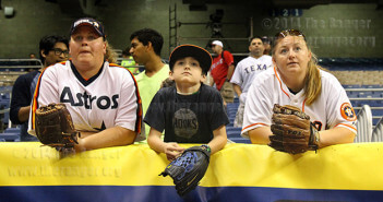 Amy Behlen, Tayler Rammel and Holly Blackman wait for a home run in left field during batting practice before the Texas Rangers and Houston Astros game Saturday in the Alamodome. Blackman brought her nephew, Tayler, whose favorite team, the Astros, defeated the Rangers 13-6. Plenty of home runs were hit during practice but none directly to left field. Photo by Carlos Ferrand