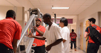 "Certified installers Deontae Sparks Chris Russell and from McCollister's Fitness Systems carry new fitness equipment today into Room 117 of Candler assisted by temporary workers Celwin Randon and Wendy Vicenti. Former kinesiology department chair Bill Richardson said the new ""functional fitness"" machines use minimal equipment to provide a workout. The equipment will be set up by the end of today and will be used by students next week. Photo by Neven Jones"