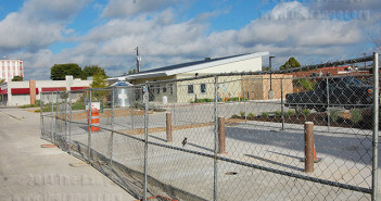 A fence surrounds the future site of a new B-Cycle station outside EcoCentro on East Locust Street across from the L&M Bookstore.  Photo by Ian Coleman