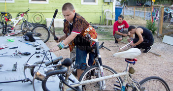 David Torres, Davis Middle School 7th-grader, reaches for a screw to bolt a handlebar to his handmade BMX bicycle Sept 2 during open shop night at EarnABike on 2619 Guadalupe St. Since mid-July, Torres has donated more than 24 hours to the co-op and built four bicycles from scratch.  Jennifer M. Ytuarte