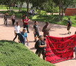 """Students from Documentaries for Social Justice protest through this campus today against racism, deportation and incarcerations happening around the U.S. The students chanted phrases such as """"Deportations mean we've got to fight back"""" and """"Racism means we've got to fight back."""" Photo By R.T. Gonzalez"""