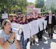 "Dental assisting sophomore Stephanie Contreras leads a chant of ""speak up!"" with students, staff and faculty from this college in a march against domestic abuse Oct. 15 that began in the women's empowerment center and ended in the Fiesta Room of Loftin. Volunteers and staff from the women's empowerment center held a clothesline with decorated T-shirts attached. Read the story online.  Photo by E. David Guel"