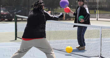 Students throw dodgeballs at each other in a dodgeball match April 2011.  File