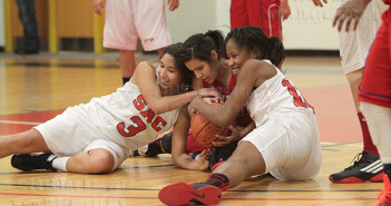 Psychology sophomore Melissa Anguiano, special education freshman Mia Garcia of the Cowgirls and sports medicine freshman Donavan Merrill wrestle for possession of the ball. The Cowgirls defeated the Lady Rangers 69-50 Wednesday in Gym 1 of Candler. Photo by E. David Guel