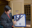 Anthropology sophomore Alex Ruiz holds a senior warden officer's apron Oct. 21 at the Scottish Rite Temple. The plumb line reminds members they are all on the same level, he said.  Photo by Neven Jones