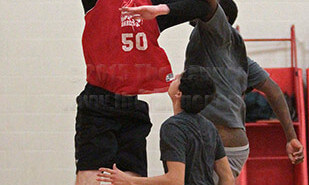 Engineering sophomore David Wright glides past education sophomore Jamar Jones for a layup Thursday during a scrimmage on the second day of basketball tryouts in Gym 2 of Candler.  Photo by E. David Guel