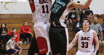 Kinesiology sophomore Andrew Butler puts up a contested shot through pre-nursing freshman Ricardo Garcia in the first half Wednesday.  Photo by E. David Guel