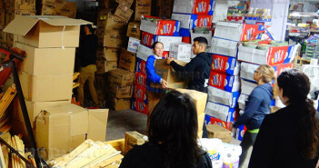 Students from this college form an assembly line to organize and inventory hundreds of boxes March 2014 at A Wider Circle, a nonprofit organization supplying essential housing products to those in need in Washington, D.C.  File
