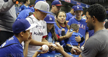 Josh Garza, 12, receives an autograph from Texas Rangers shortstop Elvis Andrus before an exhibition game between the Texas Rangers and the Los Angeles Dodgers as part of the H-E-B Big League Weekend March 21 in the Alamodome. More than 24,000 fans were in attendance.  Photo by E. David Guel