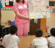 A dental assisting student shows Timmy the Explorer, a tooth who eats an apple at Travis Elementary in March 2008.  File photo